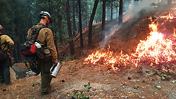July 31, 2018 - California, U.S. - Arroyo Grande Hotshots. The Ferguson Fire now in its 20th day, started July 13 on the Sierra National Forest. The fire is now 62,883 acres with 39 percent containment and 3,558 personnel that are currently engaged on the fire which include 203 engines, 43 water tenders, 14 helicopters, 95 crews, 5 masticators and 62 dozers. There has been 2 fatalities and 9 injuries to date. 1 structure has been destroyed. (Credit Image: © Rubicon/Cal Fire via ZUMA Wire/ZUMAPRESS.com)