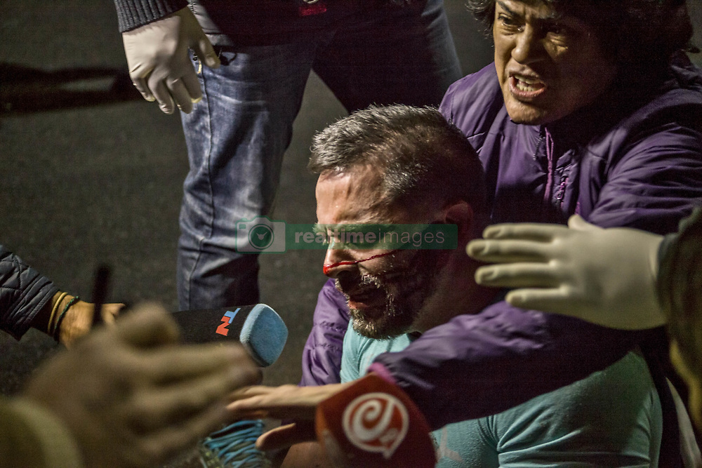April 30, 2019 - Buenos Aires, Federal Capital, Argentina - A protester, sympathizer, of the Venezuelan government of Nicolás Maduro, protested in front of the Venezuelan Embassy in Buenos Aires his repudiation against the Civic Military uprising that was taking place in Venezuela, led by the leaders of the Venezuelan opposition, Juan Guaidó and Leopoldo Lopez , and was strongly repressed by members of the Argentine Federal Police after a slight altercation arose between demonstrators who supported Juan Guaido and Leopoldo against those who supported Nicolás Maduro. (Credit Image: ©  Roberto Almeida Aveledo/ZUMA Wire)