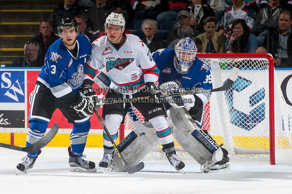 KELOWNA, CANADA - APRIL 14: Calvin Thurkauf #27 of Kelowna Rockets looks for the pass while being checked by Ryan Gagnon #3 in front of Coleman Vollrath #35 of Victoria Royals on April 14, 2016 at Prospera Place in Kelowna, British Columbia, Canada.  (Photo by Marissa Baecker/Shoot the Breeze)  *** Local Caption *** Calvin Thurkauf; Ryan Gagnon; Coleman Vollrath;
