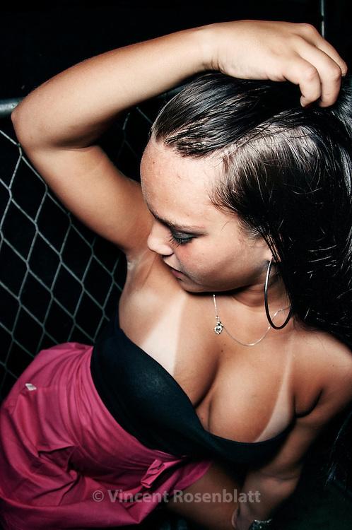 Funkeira on the dancefloor of club Boquerão, at a ball organized by Curtisomrio soundsystem, downtown Rio de Janeiro.