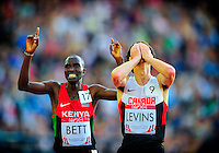 August 1 2014: Josphat Bett of Kenya (L) and Cameron Levins of Canada after finishing second and third respectively in the men's 10,000m final at Hampden Park Stadium, Glasgow at the XX Commonwealth Games in Scotland.