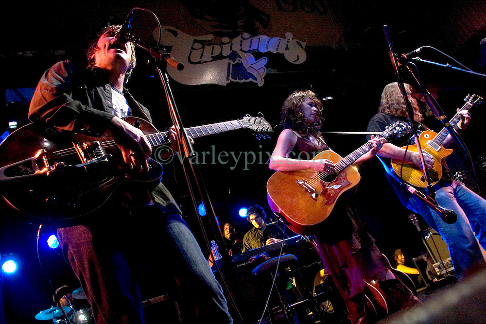 17 December, 05. Tipitina's, New Orleans, Louisiana.<br />  Arlo Guthrie and friends Riding on the city of New Orleans tour benefiting Musicares Hurricane relief 2005 sponsored by Amtrak. (l/r) Johnny Irion and his wife Sarah Lee Guthrie wow the crowd on the last date of the hugely successful tour raising money for hard hit New Orleans musicians.<br /> Photo; ©Charlie Varley/varleypix.com