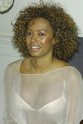 Mel B  at Guiness Book of British Hit Singles - 15th edition launch. Now available in braille!  Half length, see through, bra, breast.