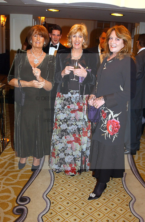 Left to right, LADY ANNABEL GOLDSMITH, ANNABEL ELLIOT sister of Camilla Parker Bowles and  LEONORA, COUNTESS OF LICHFIELD and at a dinner in aid of the BAAF (British Association for Adoption &amp; Fostering) held at The Savoy, London on 22nd March 2005.<br />