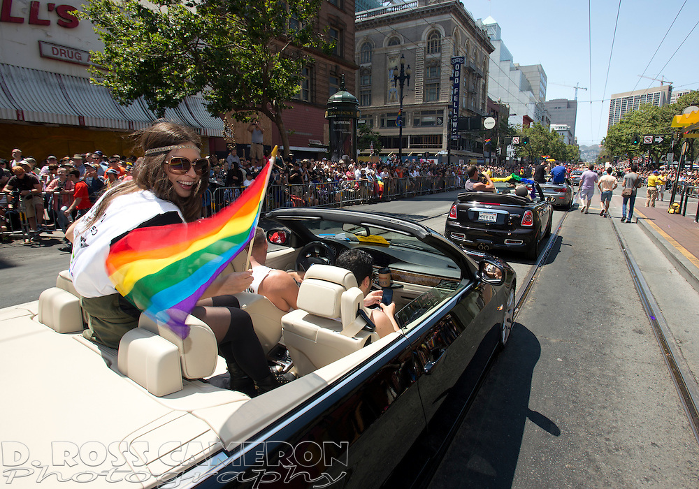 A procession of convertible cars carries VIPs down Market Street at the 43rd annual San Francisco Pride parade, Sunday, June 30, 2013 in San Francisco. (Photo by D. Ross Cameron)