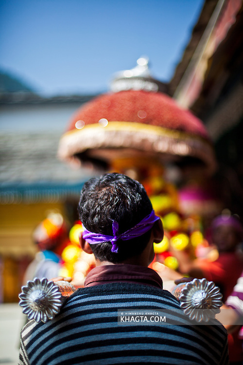 A devotee carrying the palanquin of a Deity at Lord Raghunath Temple, Kullu, Himachal Pradesh. Kullu Dussehra is the Dussehra festival observed in the month of October in Himachal Pradesh state in northern India. It is celebrated in the Dhalpur maidan in the Kullu valley. Dussehra at Kullu commences on the tenth day of the rising moon, i.e. on 'Vijay Dashmi' day itself and continues for seven days. Its history dates back to the 17th century when local King Jagat Singh installed an idol of Raghunath on his throne as a mark of penance. After this, god Raghunath was declared as the ruling deity of the Valley.