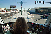 28 DECEMBER 2008 -- PHOENIX, AZ: A train operator drives her train down Washington Street in central Phoenix, AZ, Sunday. The new Metro Light Rail is 20 miles long and cost $1.4 billion dollars. Construction was funded by local, state and federal monies. The trains will operate on one line through Phoenix and the suburban communities of Tempe and Mesa. The trains started running Saturday, Dec 27, 2008 and will be free until Jan. 1, 2009. The regular fare will be $1.25 for one ride or $2.50 for an all day pass.  Photo by Jack Kurtz / ZUMA Press