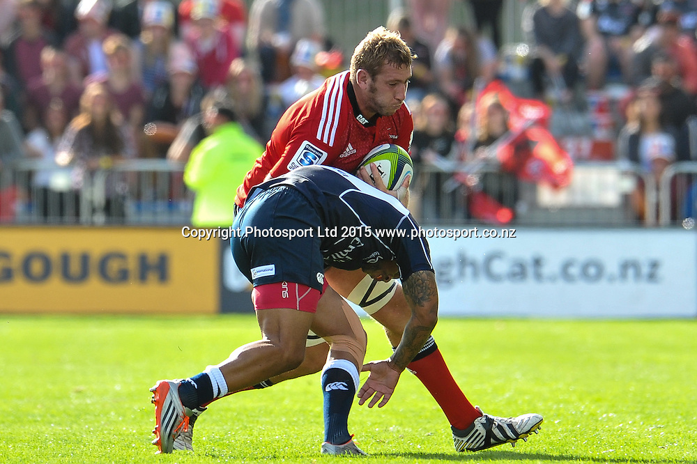 Luke Romano of the Crusaders is tackled by Lionel Mapoe of the Lions during the Super Rugby match: Crusaders v Lions at AMI Stadium, Christchurch, New Zealand, 14 March 2015. Copyright Photo: John Davidson / www.Photosport.co.nz