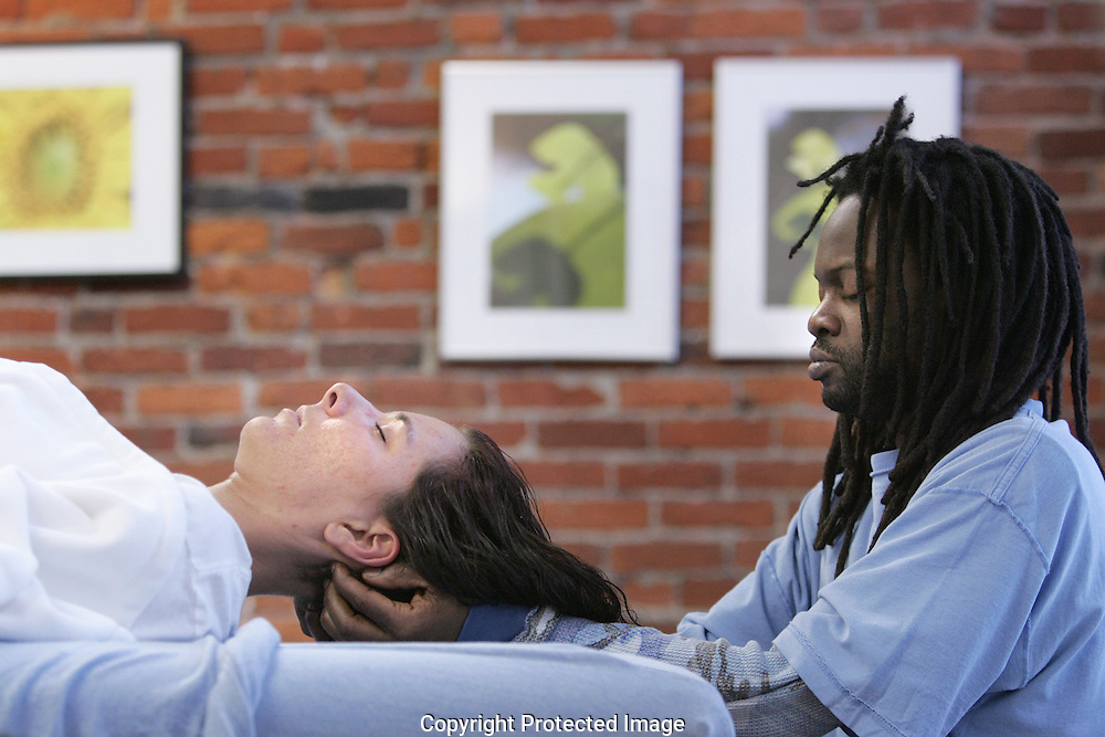 Eric Favors (right) applies polarity therapy to Christina Kyle during a Saturday class at the Columbus Polarity Center.(Jodi Miller/Alive)..Columbus Polarity Center 1253 N High St.