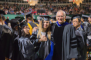 Nora Bunford (left) receives at graduate commencement with her advisor  Dr. Steven Evans, Professor and Assistant Chair for Graduate Studies in the Department of Psychology.  Photo by Ben Siegel