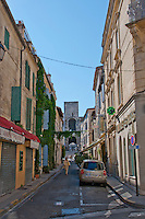 Looking up an alley towards the Coliseum in the historic city of Arles, France.