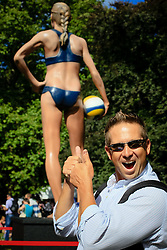 Everyone wanted their picture taken with the statue of Kerri Walsh. The men and women differed on which side of the statue to have their photo taken.