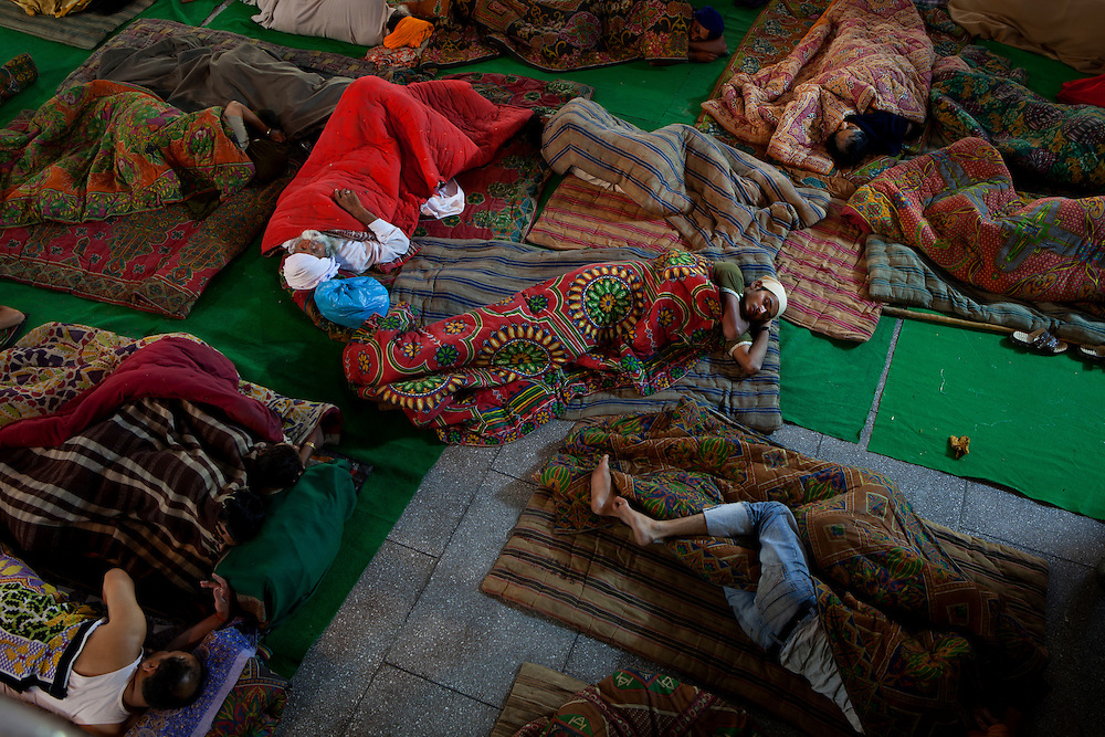 Sikh pilgrims sleep outdoors at the Golden Temple,Amritsar,India. The Golden Temple receives tens of thousands pilgrims on a daily basis.
