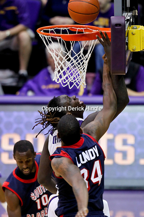 November 23, 2011; Baton Rouge, LA; LSU Tigers forward Johnny O'Bryant (2) shoots over South Alabama Jaguars forward Antione Lundy (34) during the second half of a game at the Pete Maravich Assembly Center. South Alabama defeated LSU in overtime 79-75. Mandatory Credit: Derick E. Hingle-US PRESSWIRE