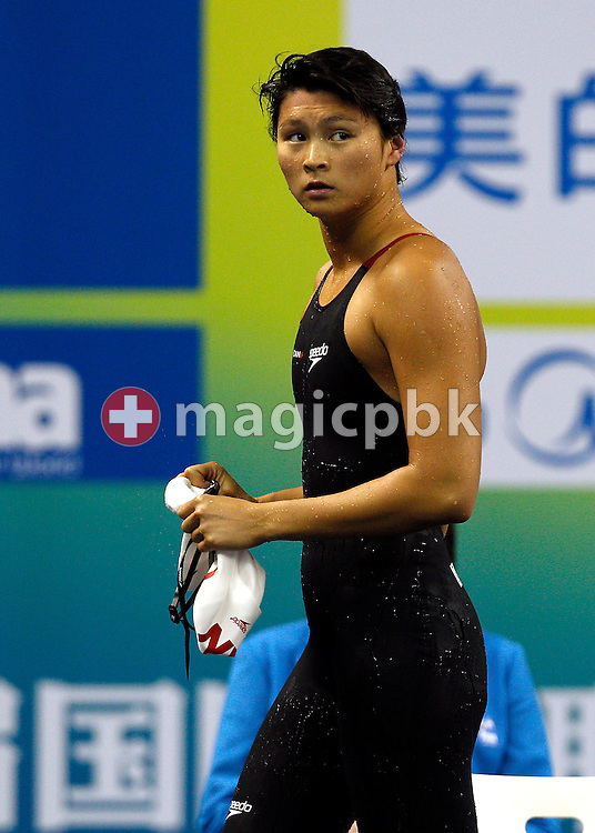 Victoria POON of Canada looks back on her way to the mixed zone after competing in the women's 100m Freestyle Semifinal during the 14th FINA World Aquatics Championships at the Oriental Sports Center in Shanghai, China, Thursday, July 28, 2011. (Photo by Patrick B. Kraemer / MAGICPBK)