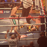 Picture by Richard Gould/Focus Images Ltd +44 7855 403186<br /> 13/07/2013<br /> Tommy Coyle (black &amp; gold) is knocked out by Derry Mathews fight for the vacant Commonwealth Lightweight title at Craven Park, Hull.