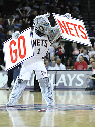 Apr 11; Newark, NJ, USA; The New Jersey Nets mascot, Sly Fox, leads fans in a cheer during the second half at the Prudential Center. The Bobcats defeated the Nets 105-103.