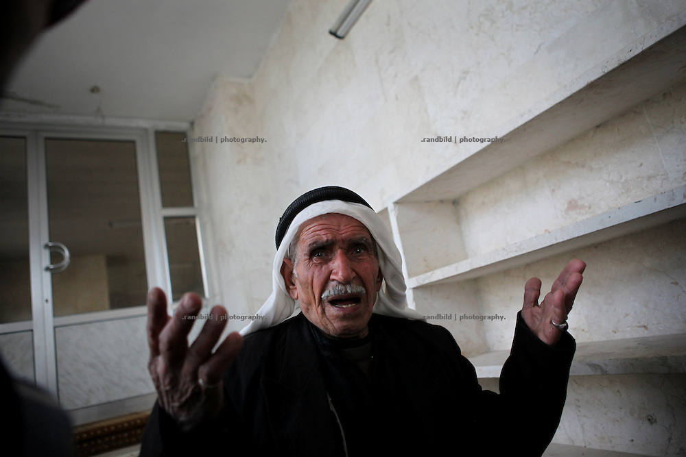 An old man mourns inside the mosque after he identified some victims of the army assault. On 22. February the syrian army attacked the village of Kureen, Province of Idlib, Syria. Kureen was among the first villages in the northwest of Syria controlled by the opposition. Some villagers and members of the defence units escaped to surrounding olive orchards, when the attack begun in the early morning. A majority of the inhabitants didn´t manage to escape. The heavy shelling lasts 7 houres. Soldiers searched all houses, burnt some of them down, loote shops, stole cars and furniture. About 60 motorcycles were burnt down. Tanks demolished several houses. 6 men were executed. One woman died as a result of an heart attack.