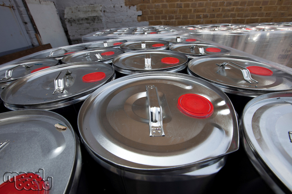 Close-up of tins outside warehouse