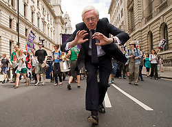 Picture by Mark Larner. Picture shows a man dancing towards camera during the No to Cuts protest by teachers and other public sector workers. London 30/06/2011