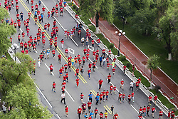 June 25, 2017 - Jili, Jili, China - Jilin, CHINA-June 25 2017: (EDITORIAL USE ONLY. CHINA OUT) ..A red marathon is held in Jilin, northeast China, June 25th, 2017. About 30,000 runners from 17 countries and regions around the world attend the marathon. Ethiopian runners Bekuma Haile Tolossa and Bexele Abebech Tsegaye win the championship of men's and women's race respectively. (Credit Image: © SIPA Asia via ZUMA Wire)