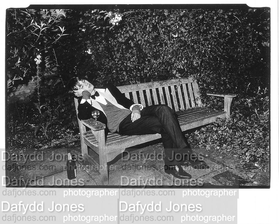 'Bullingden' boy asleep on bench, Christchurch May Ball, Oxford© Copyright Photograph by Dafydd Jones 66 Stockwell Park Rd. London SW9 0DA Tel 020 7733 0108 www.dafjones.com