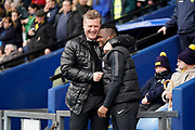 Oxford United manager Karl Robinson greats Aaron Maclean of Peterborough United during the EFL Sky Bet League 1 match between Oxford United and Peterborough United at the Kassam Stadium, Oxford, England on 16 February 2019.