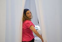 Yvonne Wilhelm of Knowbotic Research while installing Naked Bandit. KR is Christian Hubler, Alexander Tuchacek and Yvonne Wilhelm. Synthetic Times exhibition at NAMOC, Beijing, China.Synthetic Times exhibition at NAMOC, Beijing, China.