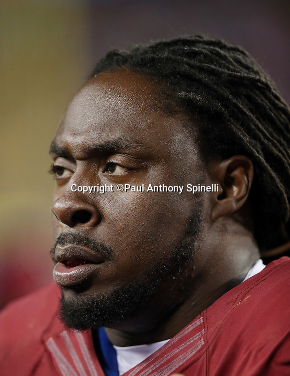Washington Redskins defensive tackle Ricky Jean Francois (99) looks on from he sideline during the 2015 week 13 regular season NFL football game against the Dallas Cowboys on Monday, Dec. 7, 2015 in Landover, Md. The Cowboys won the game 19-16. (©Paul Anthony Spinelli)