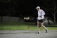 Augusta, New Jersey - Scott Brockmeier runs at night during the 3 Days at the Fair races at Sussex County Fairgrounds on May 15, 2010.