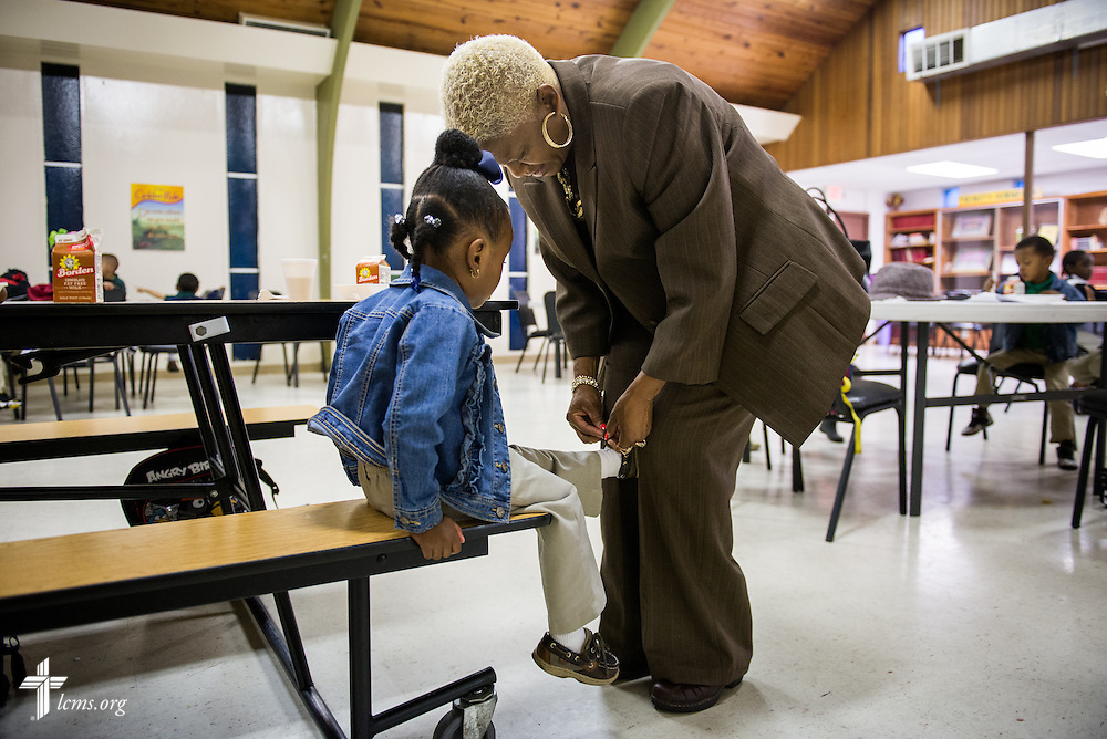 Preschool teacher Victoria Richardson ties the shoe of a student before classes start at Trinity Evangelical Lutheran School on Monday, April 7, 2014, in Mobile, Ala. LCMS Communications/Erik M. Lunsford