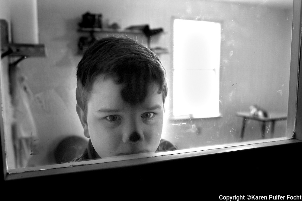 April 19, 2012 -  William Bryant is a 9 year old boy with Autism. He spends most of his day behind a locked door in a clear and simple room. HIs parents are providing him space without too much external stimulation. (  By Karen Pulfer Focht/ The Commercial Appeal)