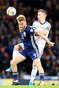 Scotland forward Oliver McBurnie (9) (Sheffield United) and Andrey Semenov of Russia (5) (Akhmat Grozny) during the UEFA European 2020 Qualifier match between Scotland and Russia at Hampden Park, Glasgow, United Kingdom on 6 September 2019.