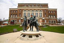 "The statue of Abraham Lincoln, Jesse Fell and David Davis in front of the McLean County Center for the Performing Arts has been ""masked"" for the COVID-19 (Novel Coronavirus)) by the #blonoyarnbomb"