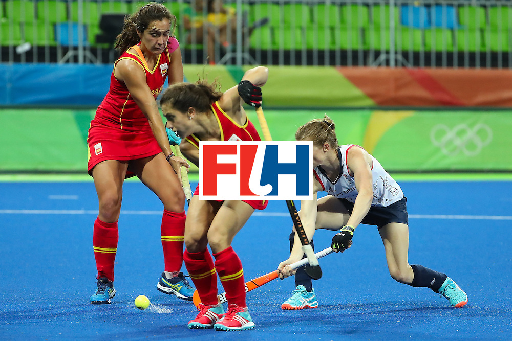 RIO DE JANEIRO, BRAZIL - AUGUST 15:  Helen Richardson-Walsh #8 of Great Britain deflects in a first half goal past Georgina Oliva #23 of Spain during the quarter final hockey game on Day 10 of the Rio 2016 Olympic Games at the Olympic Hockey Centre on August 15, 2016 in Rio de Janeiro, Brazil.  (Photo by Christian Petersen/Getty Images)