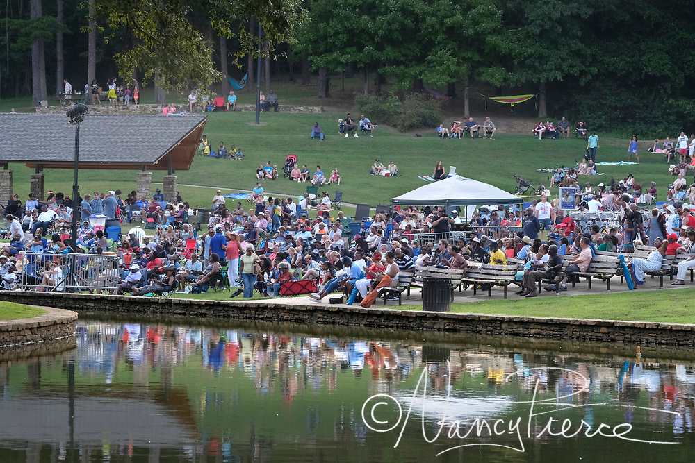 Freedom Summer Series. Jazz at Freedom Park, This one is Freeport Jazz opening for Nick Colionne. Audience members on the terraced lawn in front of the concert stage.