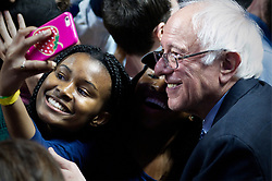 Democratic candidate Bernie Sanders poses for photos with members of the crowd after a rally in Philadelphia, PA, on April 6, 2016.