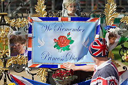 © Licensed to London News Pictures. 31/08/2013. London, UK. Tributes to Diana Princess of Wales are seen on the gates of Kensington Palace in London today (31/08/2013) on the 16th anniversary of her death in Paris (1997). Photo credit: Matt Cetti-Roberts/LNP