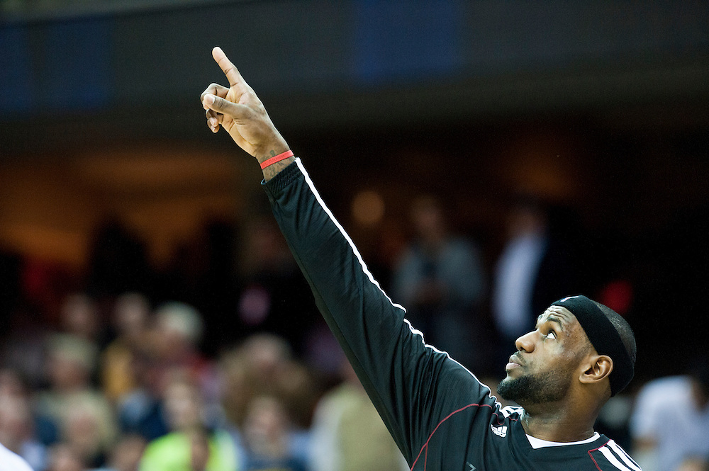CLEVELAND, OH - MARCH 20: LeBron James #6 of the Miami Heat points to the scoreboard which has a technical malfunction prior to the game between the Cleveland Cavaliers and the Miami Heat at Quicken Loans Arena on March 20, 2013 in Cleveland, Ohio. NOTE TO USER: User expressly acknowledges and agrees that, by downloading and or using this photograph, User is consenting to the terms and conditions of the Getty Images License Agreement. (Photo by Jason Miller/Getty Images)  *** Local Caption *** LeBron James;