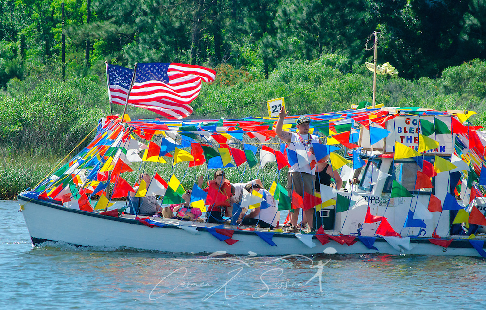 A decorated boat travels down the bayou during the 66th annual Blessing of the Fleet in Bayou La Batre, Alabama, May 3, 2015. The first fleet blessing was held by St. Margaret's Catholic Church in 1949, carrying on a long European tradition of asking God's favor for a bountiful seafood harvest and protection from the perils of the sea. The highlight of the event is a blessing of the boats by the local Catholic archbishop and the tossing of a ceremonial wreath in memory of those who have lost their lives at sea. The event also includes a land parade and a parade of decorated boats that slowly cruise through the bayou. (Photo by Carmen K. Sisson/Cloudybright)