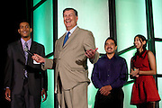 Dallas Mayor Mike Rawlings (center) jokes around with Aaron Williford (left), Jazmin Tule and her father Enrique Tule (right) during the Mayor's Intern Fellows Program closing celebrations at the Hyatt Regency in Dallas on Friday, August 9, 2013. (Cooper Neill/Special Contributor)