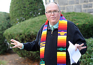 Rev. Jeffrey A. Wargo conducts a blessing of pets ceremony Sunday, October 23, 2016 at St. Stephen's United Church of Christ in Perkasie, Pennsylvania. (Photo by William Thomas Cain)