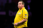 Dave Chisnall on the verge of exiting the Premier League  during the Premier League Darts  at the Motorpoint Arena, Cardiff, Wales on 31 March 2016. Photo by Shane Healey.