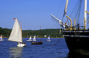 Image of sailboats and the Charles W. Morgan whaling ship at Mystic Seaport, Connecticut, American Northeast