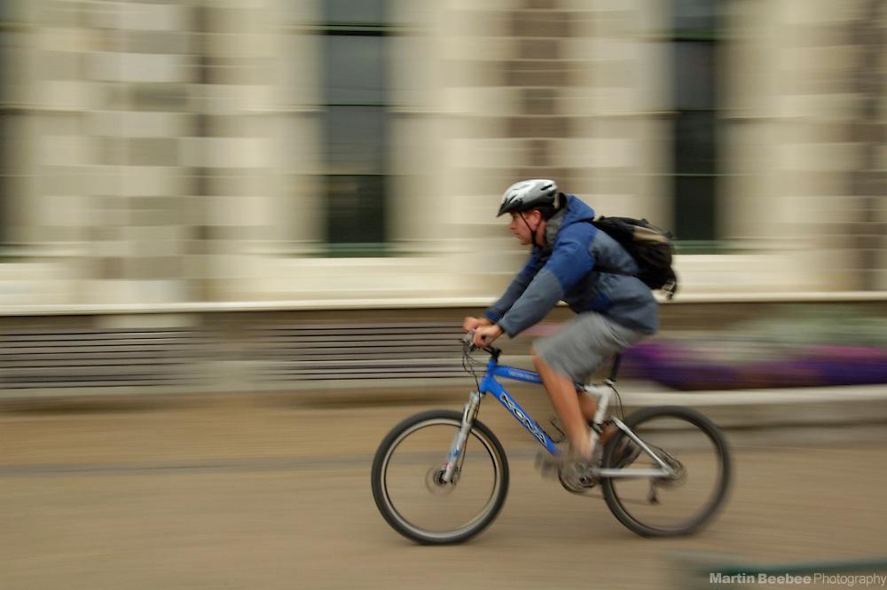 Cyclist riding through downtown Christchurch, New Zealand