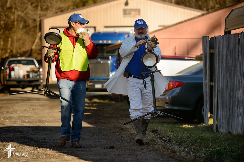 Travis Torblaa, mission and ministry director of New Beginnings Lutheran Church in Pacific, Mo., walks with a fellow volunteer during a cleaning event at a flood-damaged home in Fenton on Thursday, Jan. 14, 2016. LCMS Communications/Erik M. Lunsford