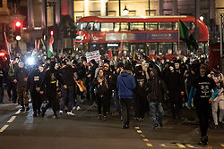 © Licensed to London News Pictures. 05/11/2018. London, UK. Demonstrators take part in the Million Mask March, an anti-capitalist protest organised by Anonymous UK. The march takes place on bonfire night, the anniversary of Guy Fawkes' plot to blow up the Houses of Parliament with gunpowder. Photo credit : Tom Nicholson/LNP