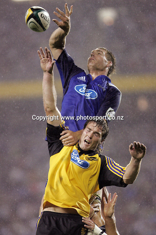 Ali Williams pushes Jason Eaton down in the lineout during the Rebel Sport Round One Super 14 rugby union match between the Hurricanes and the Blues at Eden Park, Auckland, New Zealand on Friday 10 February, 2006. The Hurricanes won the match, 37 -19. Photo: Hannah Johnston/PHOTOSPORT<br /><br /><br /><br /><br />146032