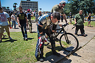 """Van, a veteran from Los Angeles, CA catches his breath after getting in a fight with some white extremists. He came to New Orleans to stand up to the """"Antifa"""", and protect people who the """"Antifa"""" try to shut up."""