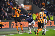 Hull City midfielder Jackson Irvine (4) and Millwall FC defender Mahlon Romeo (12)  during the EFL Sky Bet Championship match between Hull City and Millwall at the KCOM Stadium, Kingston upon Hull, England on 6 March 2018. Picture by Ian Lyall.